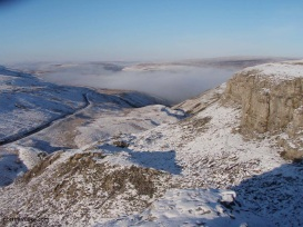 oxnop scar, crow trees road and valley mist in swaledale